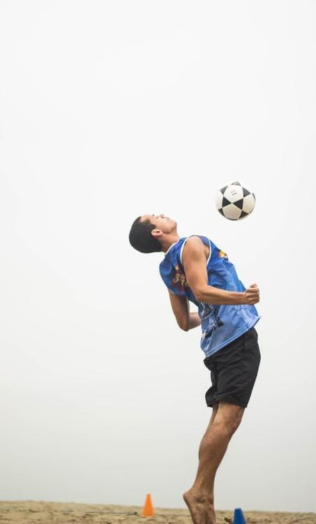A man practicing a soccer trick