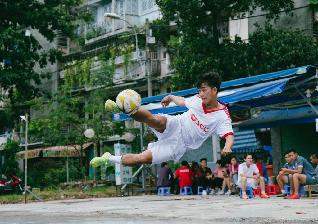 A player kicks a ball