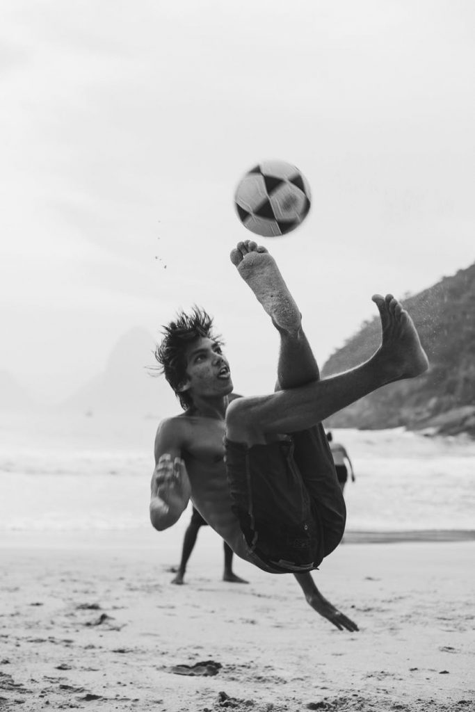 Male playing Beach Soccer